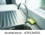 water running from a tap into a ...   Shutterstock . vector #639136501