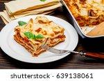 portion of tasty lasagna on... | Shutterstock . vector #639138061