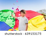 happy boy playing active... | Shutterstock . vector #639153175