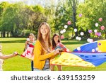 happy fair haired girl playing... | Shutterstock . vector #639153259