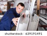 serious production worker in... | Shutterstock . vector #639191491