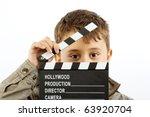 boy with movie clapper board... | Shutterstock . vector #63920704