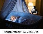 adorable baby drinking milk in... | Shutterstock . vector #639251845