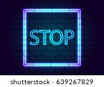 a neon sign in button stop...   Shutterstock .eps vector #639267829