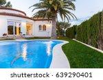 swimming pool on villa in spain | Shutterstock . vector #639290401