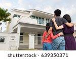 parents and kid standing in... | Shutterstock . vector #639350371
