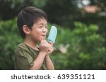 cute asian child eating blue... | Shutterstock . vector #639351121