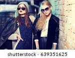 fashion portrait of two young... | Shutterstock . vector #639351625
