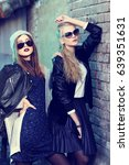 fashion portrait of two young... | Shutterstock . vector #639351631