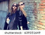 fashion portrait of two young... | Shutterstock . vector #639351649