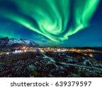 an insane aurora borealis... | Shutterstock . vector #639379597