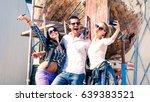 happy friends taking selfie... | Shutterstock . vector #639383521