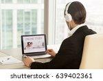 man in headphones at of laptop... | Shutterstock . vector #639402361