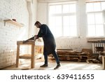 young trained carpenter working ... | Shutterstock . vector #639411655