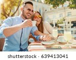 flirting in a cafe. beautiful... | Shutterstock . vector #639413041