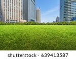 buildings and green lawn | Shutterstock . vector #639413587