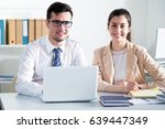 business people are looking... | Shutterstock . vector #639447349