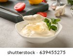 delicious mayonnaise in bowl... | Shutterstock . vector #639455275