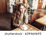 pretty girl talk on the phone... | Shutterstock . vector #639464695