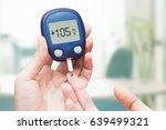 woman doing blood sugar test | Shutterstock . vector #639499321