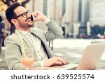 young businessman using his... | Shutterstock . vector #639525574