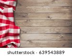 red picnic tablecloth on wood...   Shutterstock . vector #639543889
