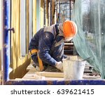 the worker makes the sladding... | Shutterstock . vector #639621415