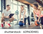 gym instructor assisting two... | Shutterstock . vector #639630481