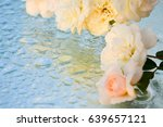 beautiful roses reflected in... | Shutterstock . vector #639657121
