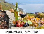 red wine and a branch of grapes ... | Shutterstock . vector #63970405