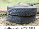 Old Tires Lying On The Grass....