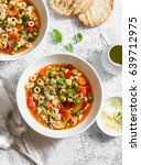Small photo of Vegetarian minestrone - delicious healthy mediterranean lunch. On a light table, flat lay