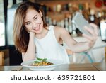 young asia woman eating... | Shutterstock . vector #639721801