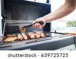 hand of young man grilling some ... | Shutterstock . vector #639725725