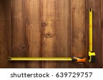 Tape measure tools on wooden...