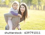 happy mother and little... | Shutterstock . vector #639791011
