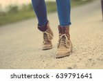 traveler woman legs on the road | Shutterstock . vector #639791641