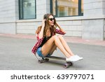 young woman sitting on the... | Shutterstock . vector #639797071