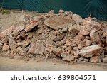 pile of broken red bricks on... | Shutterstock . vector #639804571