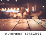 wood table top with blur light... | Shutterstock . vector #639813991