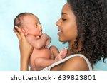 tender african mother holding... | Shutterstock . vector #639823801