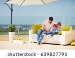 happy family relaxing on roof... | Shutterstock . vector #639827791