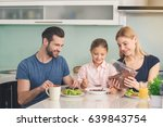 young family having breakfast... | Shutterstock . vector #639843754