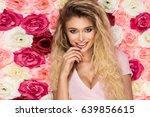 beautiful blonde girl in pink... | Shutterstock . vector #639856615