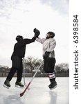 Two Boys In Ice Hockey Uniform...
