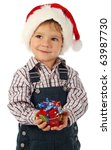Smiling little boy with little Christmas gift box - stock photo