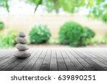 zen stones on wooden in... | Shutterstock . vector #639890251