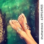 tanned well groomed feet amid... | Shutterstock . vector #639914905