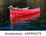 Red Boats Floating On Calm...