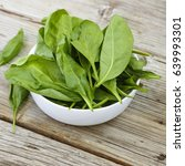 spinach in a white bowl on a... | Shutterstock . vector #639993301
